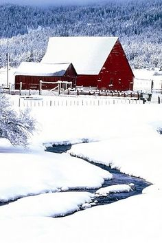 Red barn and snowy stream