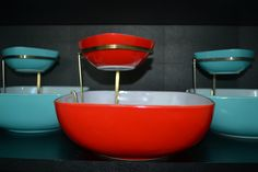 Vintage Pyrex. Red and teal chip and dip sets. LOVE!  I've never seen these first hand, but I love the red.