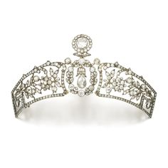 DIAMOND TIARA, CIRCA 1900 The centre designed as two wreaths, each swing-set to the centre with circular-cut and pear-shaped diamonds, between two modified rectangular panels of open work floral and foliate design, set with circular-cut and rose diamonds, inner circumference approximately 290mm, central motif detachable and can be worn as a brooch or pendant, the panels can be worn as brooches.