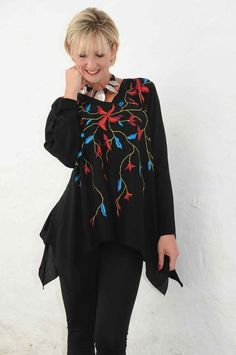 Angel Circle black tunic with red/cyan embroidered flowers.314