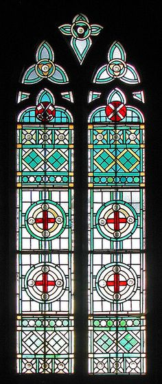 Red crosses - In the chancel of St Mary & St John, Oxford. Sometimes simple  geometric shapes and patterns like this can be rather effective and  presumably more economical than figurative stained glass windows. Of  course, this also incorporates the cross of St George, patron of the  Realm.