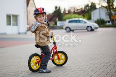 Little toddler boy learning to ride on his first bike Royalty Free Stock Photo