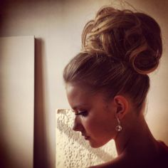 """If you pin your hair in place, instead of an actual """"messy bun"""", it looks much more classy....and no one will know that you didnt wash your hair (;"""