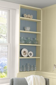 colored walls from behind white shelves/painted paneling/built in - could work to right of door way