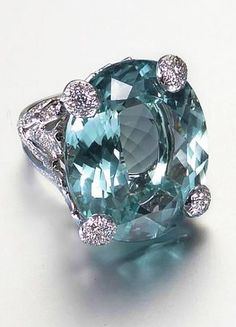 An aquamarine and diamond dress ring, by Dior The large oval-cut aquamarine within an openwork foliate mount pavé-set with brilliant-cut diamonds, aquamarine approx 54.00 carats, diamonds approx 2.00 carats total, signed Dior, numbered, French assay marks, fitted case by Dior. Love this one. B.