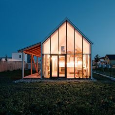 Night view of a family house in Slovakia with a glazed gable wall