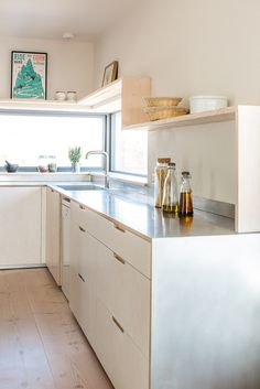 Contemporary eco kitchen with stainless steel worktop finish. Two side-by-side three-drawer cabinets offer masses of storage. With two deep drawers ideal for pots and pans, a third slimmer drawer offers a fitting space for utensils and cutlery.