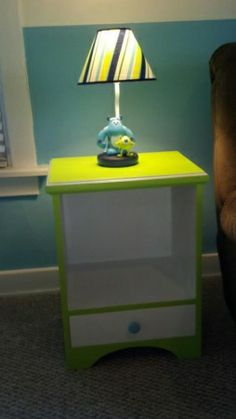 Monsters inc. themed nursery , Side table with monster lamp. Hmmm I wonder if I could do this with me side table.