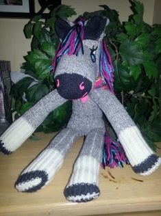 One day I was scrolling thru things to make for my grandson for Christmas. I came across this cute sock horse that was make just like a sock monkey. Now that Christmas is almost upon us I figured… Sock Monkey Pattern, Sock Monkey Baby, Make A Dinosaur, Dinosaur Stuffed Animal, Sock Toys, Sock Animals, Cute Socks, How To Make Clothes, Diy For Girls