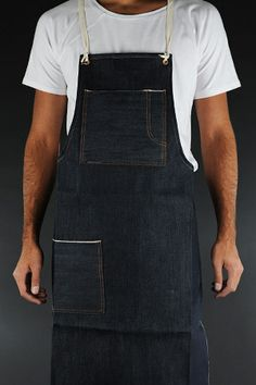 """Ditch the lame """"#1 Cook"""" cover and don something more stylish for your holiday cooking with the Indigofera Selvage Denim Apron ($115). Made from unwashed selvage denim and sporting white straps and featuring a large torso pocket with a separate utensil slot, and a lower, hip-level pocket, it's a great way to keep from looking dorky while protecting your clothes from errant splashes and spills."""