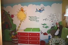 Dr. Seuss Land, a gender neutral nursery - The background of the mural was drawn onto the wall using a projector.