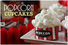 "popcorn movie cupcakes - vanilla cupcakes, buttercream frosting with marshmallows on top. The ""popcorn"" bottoms are printed strips wrapped around the cupcake wrappers."