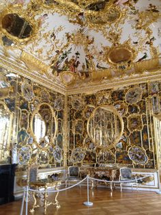 This German rococo room shows how even without the straight lines of french rococo, circular shapes are still framed with gold leafing.