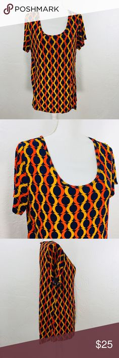 LuLaRoe Classic Tee Circle Abstract Print Armpit to armpit flat across is 22 inches Length is 27 and 31 inches Short Sleeve, Scoop neck 100% Rayon Colors are navy yellow and orange All items are shipped within 24 hours except Sundays. Check measurements carefully to ensure proper fit. Thank you for supporting my small business. H37/4-5/18/4 LuLaRoe Tops
