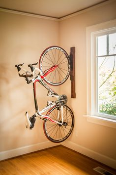 Amazing space-saving dirt bike storage ideas for small room and apartments. These indoor bike storage solutions are for pedal pushers who can't part with their bike. Vertical Bike Storage, Indoor Bike Storage, Overhead Garage Storage, Bicycle Storage, Diy Bike Rack, Bike Hanger, Bicycle Rack, Tandem Bicycle, Wall Mount Bike Rack