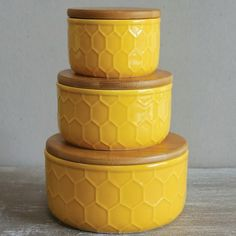 Gold Ceramic Canisters With Wood Lids and a sweet, honeycomb design are a breath of fresh air for your decor. For more ceramic kitchen canisters visit Antique Farmhouse. Ceramic Canister Set, Ceramic Jars, Kitchen Canisters, Kitchenware, Paperclay, Save The Bees, Bees Knees, Deco Table, Mellow Yellow