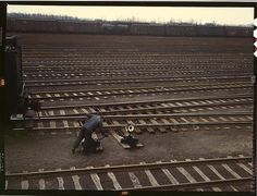 """""""Switchman throwing a switch at Chicago and Northwest Railway Company's Proviso yard. Chicago, Illinois, April 1943. Reproduction from color slide. Photo by Jack Delano. Prints and Photographs Division, Library of Congress"""" (Denver Post)"""