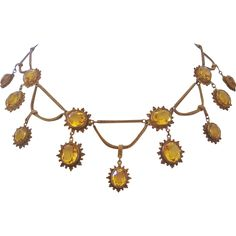 For your consideration a truly rare find in vintage costume jewelry.  This piece dates from the Edwardian era when the festoon necklace was popular.