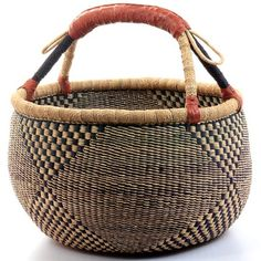 Ghana Bolga basket... I would love a colorful one with some blue for in the living room.