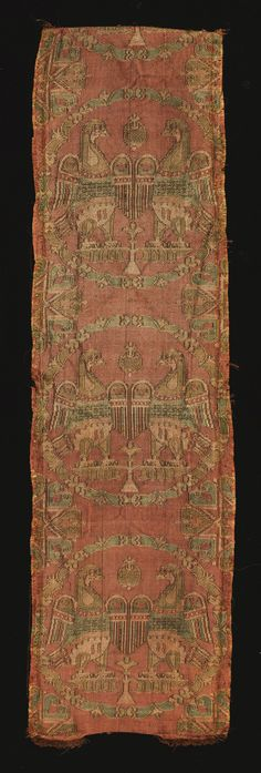 Sogdian silk lampas textile fragment, Central Asia, 8th/9th Century woven in red, green, blue and cream silk threads with repeating roundel designs with pairs of pheasants, the roundels consisting of several concentric elements or curving coloured petals with a variety of motifs depicted between them 58.4 by 14.8cm.