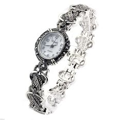 Firewings Womens Vintage Marcasite Crystal Silver Tone Mother of Pearl Rope Design Watch