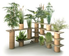 Share 	Tweet 	Pin 	Mail  Végétagère, a hybrid plant trellis shelving system composed of modular wood shelves with openings to accept stackable vegetable fiber pots, debuted at last spring's Jardins Jardin, the edgy urban garden design show in Paris's Tuilleries Gardens.… Read More...
