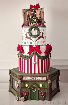 Amazing Christmas story cake over four tiers with toy shop, candy stripes and edible wreath [ Christmas Themed Cake, Christmas Cake Designs, Christmas Cake Decorations, Holiday Cakes, Christmas Desserts, Christmas Treats, Christmas Baking, Christmas Cakes, Fondant Christmas Cake