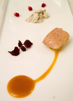Goose pate, pomegranate, wasabi foam and honey mustard sauce at Signature Restaurant in Warsaw