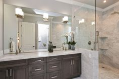 Love the look. comlpex marble, sunken vanity lights mounted in the mirrors walk in shower, rain shower.. it's perfect