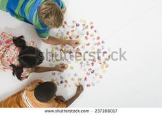 Children Working on Jigsaw Puzzle - stock photo