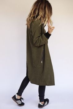 Army green zip coat.. Don't own anything like it, but it appeals to me