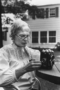 Photographer Margaret Bourke-White, who suffers from Parkinson's disease, able to load her camera after brain surgery to relieve the disease and intenvise physical rehabilitation. Location: CT, US Date taken: 1959 Photographer: Alfred Eisenstaedt
