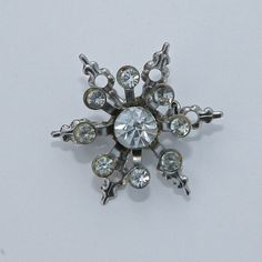 Rhinestone Snowflake Brooch by FallingLeafDesigns on Etsy, $6.00