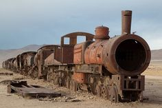 Abanonded steam engine in Uyuni train cemetery, Bolivia. Photo By jimmyharris  There's train cemeteries!! so steampunk
