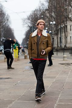 On the Street…. Arco della Pace, Milan « The Sartorialist  Love how the red pops out amongst its neutral garments.