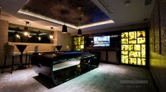 From a bland white underground space to a super-tech man cave garage entertaining space.