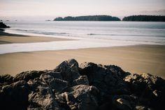 Rocks overlooking smooth sand beach #freestockphotos