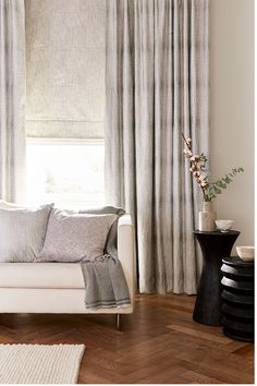 These chic silver tones create a soothing escape from the busy lives we lead. The subtle sheen from the Serenity Shimmer curtains softly frames the window, creating a bright, airy room filled with healing daylight. House Beautiful, Beautiful Homes, Grey Interiors, Made To Measure Curtains, Living Room Interior, Photoshoot Ideas, Window Treatments, Dressings, Blinds