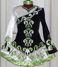 I like the design across the top and the different coloured sleeves on this Irish dance solo dress