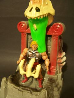 """The Evil Horde's Slime Pit, a playset that trapped a figure and coated it with goo emitted from a skull, from the """"Masters of the Universe"""" line of toys"""