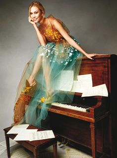 """Karlie Kloss in """"New Year, New Look"""" for Glamour US, January 2015. Photographed by Patrick Demarchelier. """"Hit the Note. It's never too late to pick up (or relearn) an instrument. Just ask Kloss, who played piano throughout her childhood and is now starting lessons again. An ethereal tulle gown like this will make your next performance simply magical. Delpozo gown. Fred Leighton earrings. No. 21 shoes, $536."""""""