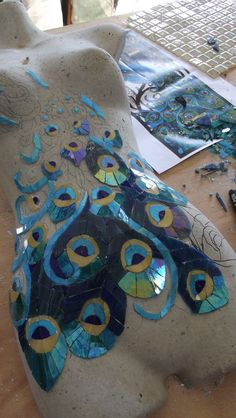 Mosaic peacock on a bust - work in progress. Chosen to do this one in glass due to the variations available. Time consuming and expensive, but hopeful of the results - by Sandra Holmes