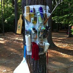 Tie a shoe rack around a tree to hold all your stuff.