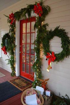Love the red door with the greenery!