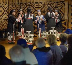 Women wearing traditional Ainu clothes sing and dance before tourists at the Ainu Museum in the town of Shiraoi in Hokkaido on Oct. 24.