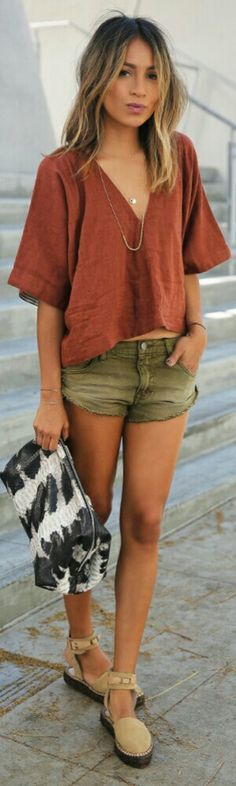 Fashion trends | Burnt orange v-neck top, khaki shorts, flats, clutch