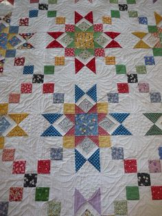 small prints, lots of white. My kind of quilt!.