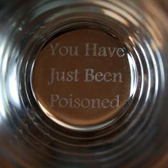 Once you finish your beverage, you'll realize, too late, that you have been poisoned! Or at least that's what you'll see etched on the bottom of your glass. Spy Shows, Diy Bar, Bar Accessories, Drinking Glass, Glass Etching, Etched Glass, Man Humor, Bars For Home, Pint Glass