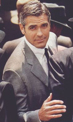 George Clooney in grey suit, button down custom dress shirt...BOOM !