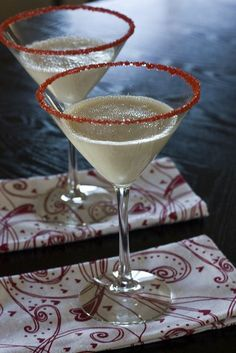 Cloud Nine Martini Serves 2 6 oz Godiva White Chocolate liqueur 2 oz Pinnacle Whipped Cream vodka Rim 2 martini glasses with whipped cream vodka and red sugar crystals. Fill a cocktail shaker halfway with ice. Pour ingredients into the shaker and shake .
